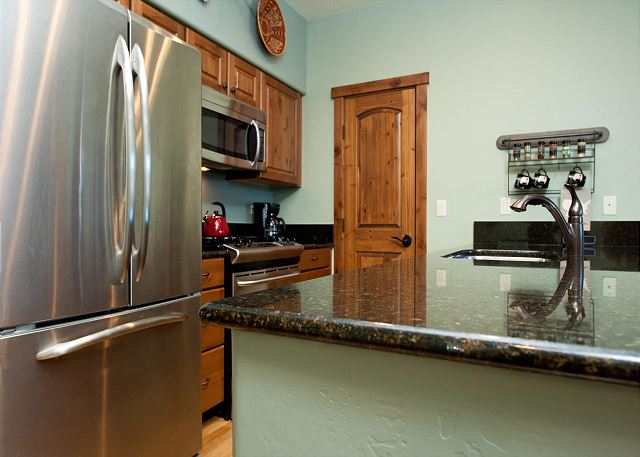 Kitchen with tea kettle and traditional drip coffeemaker