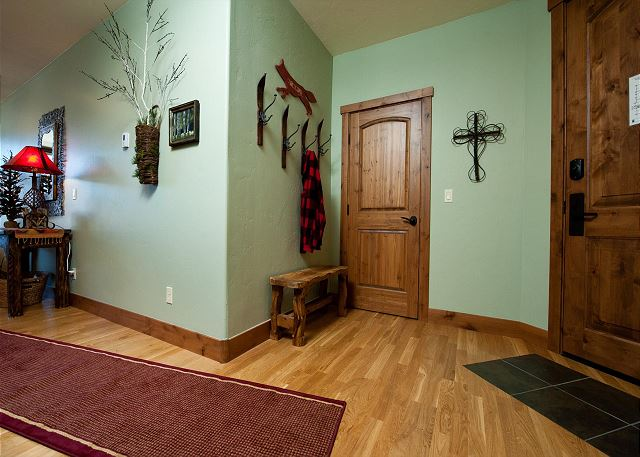 Entryway with coat rack and bench.