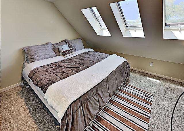King bed in loft bedroom. Second floor.