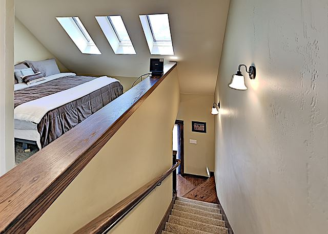 Staircase to second floor with both bedrooms.