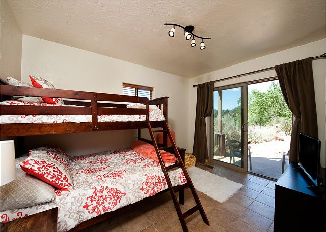 Bedroom 5 - Bunk Bed (Single over Double) - TV (Streaming only) and patio.