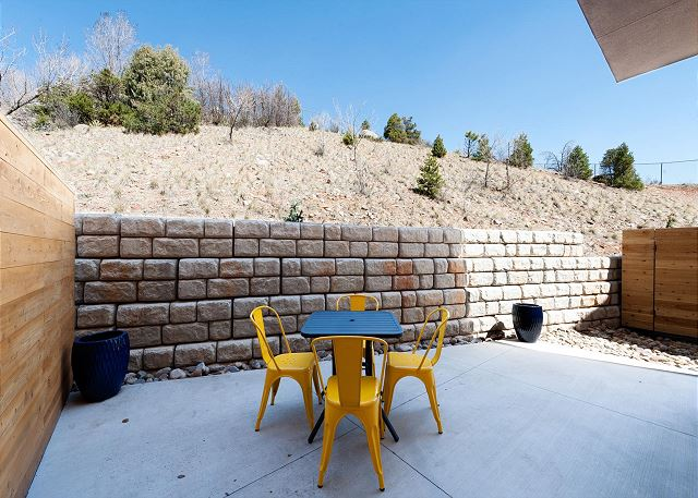 Private outdoor seating area with gas grill