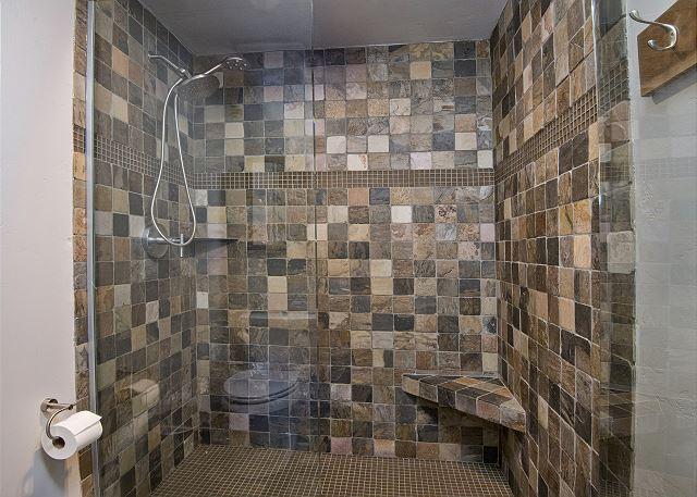 Walk-in glass shower.