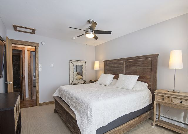 Main bedroom with a King bed.  Ceiling fan to move air around in the summer months.