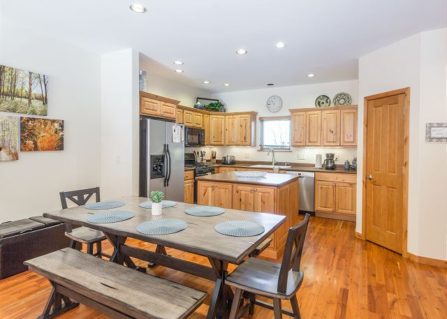 Fully-equipped kitchen with dining area.
