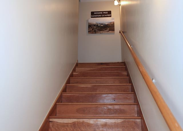 Stairs leading from ground level to main living space.