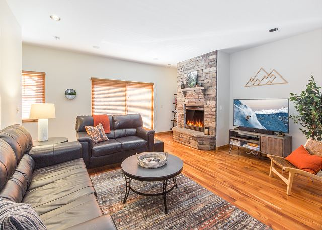 Main living space with gas fire place.