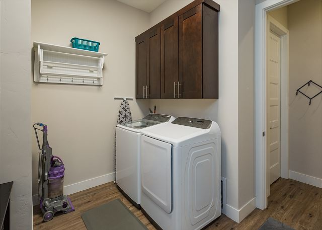 Laundry room with full size washer and dryer