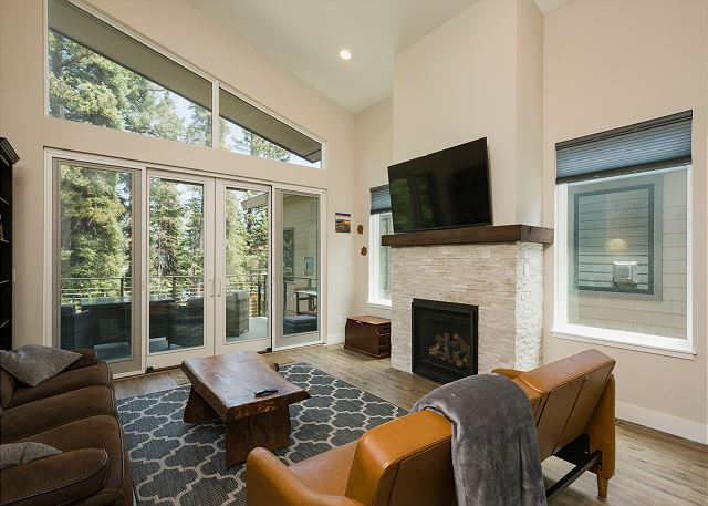 Living room with TV and gas fireplace and access to main deck
