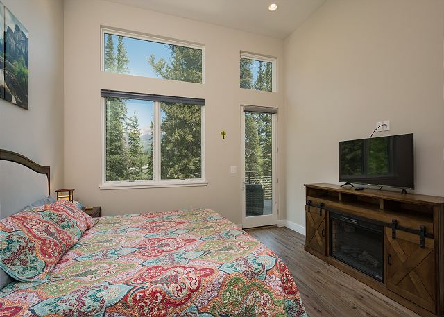 Master bedroom - King bed, TV and deck access