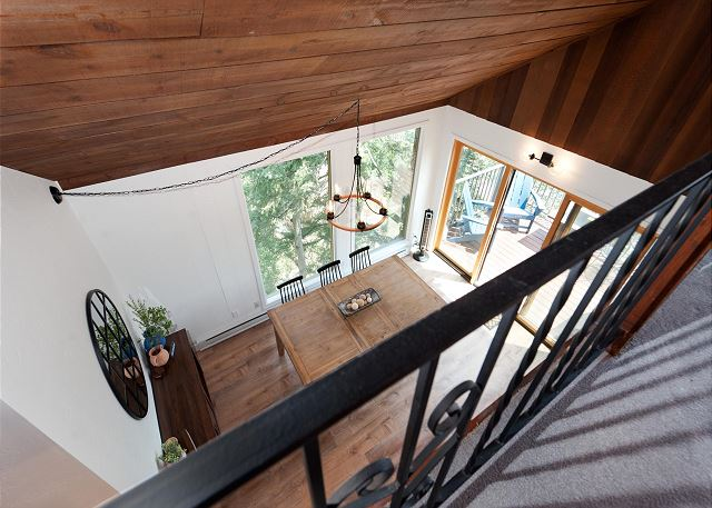 Overlook from the loft (with 3 twin beds) into the dining space