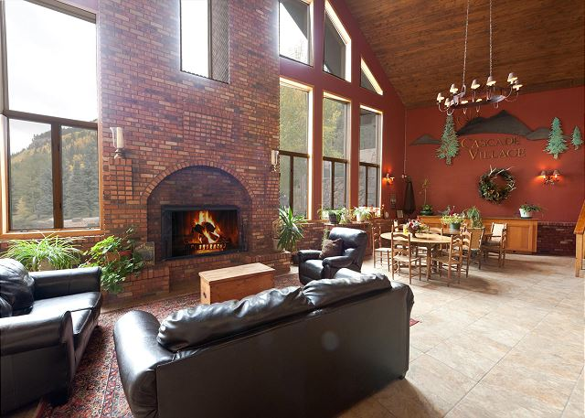 Cascade Village Lodge main lounge area with seating and fireplace.
