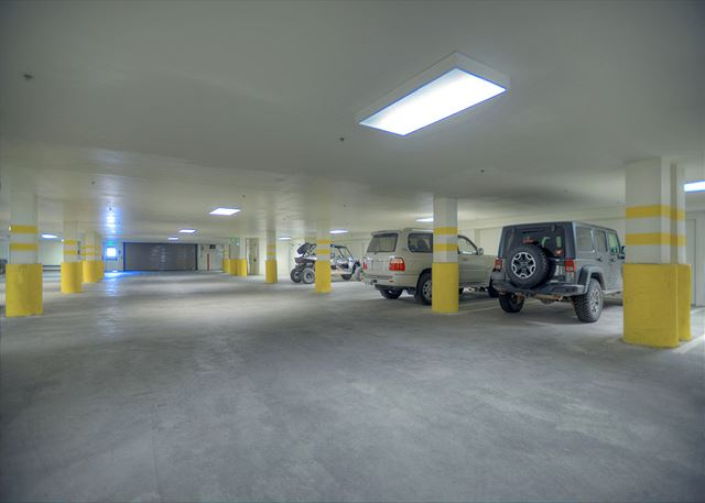 Heated garage under the building with one parking spot assigned to the condo.  Additional parking in the parking lot in front of the building