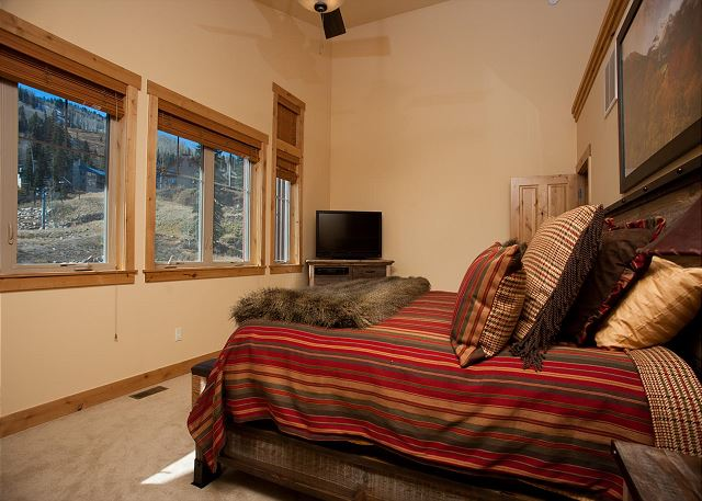 Bedroom with king size bed, ceiling fan, and TV