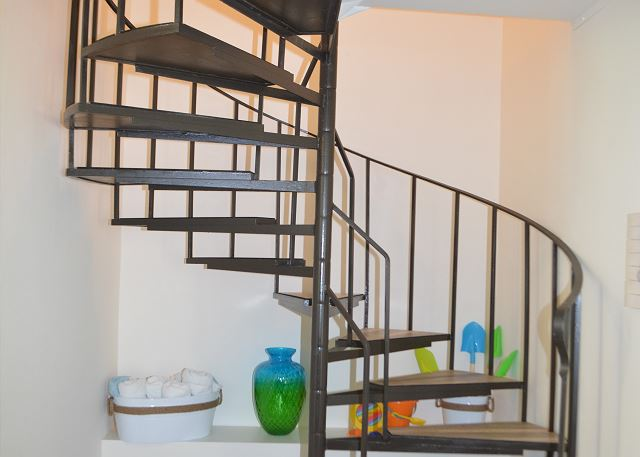 Stairs leading up to the bedrooms and bathrooms.