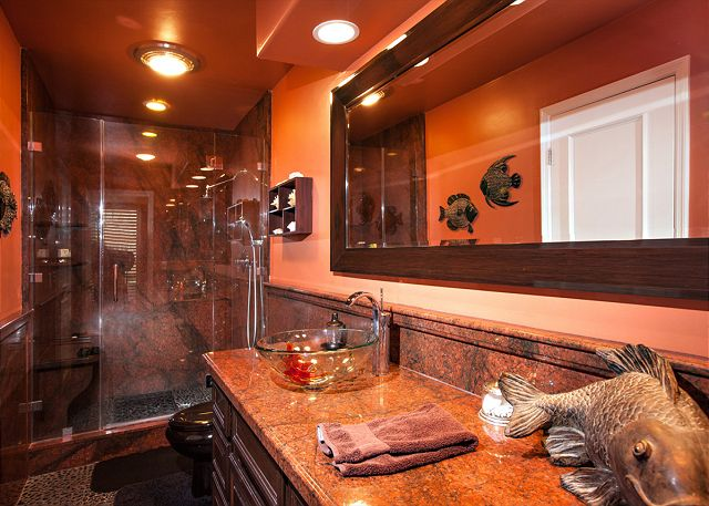 Beautifully decorated bathroom with large step-in shower