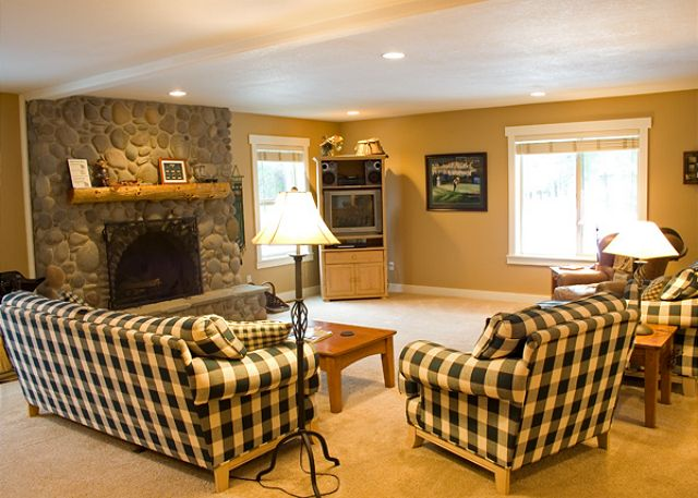 Very open and spacious living room with a wood burning fireplace.
