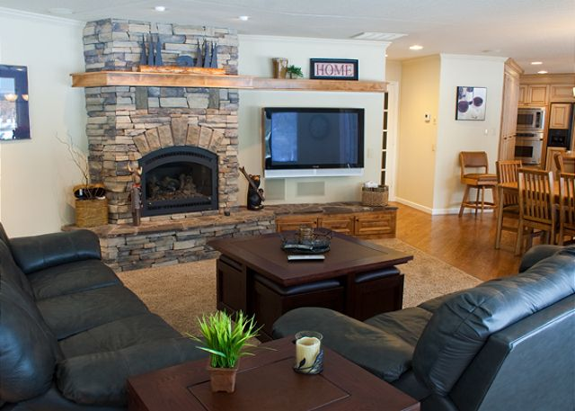 Large comfortable great room with lots of natural light, gas fireplace and flat screen TV.