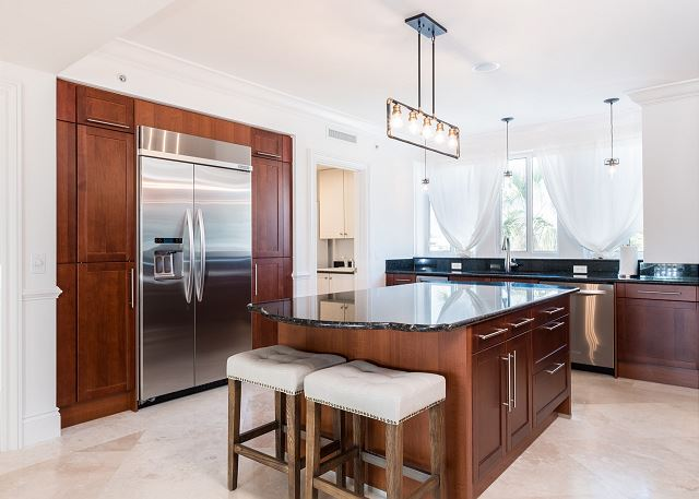Residence #3822 - Spacious Kitchen with Center Island and Adjoining Laundry Room