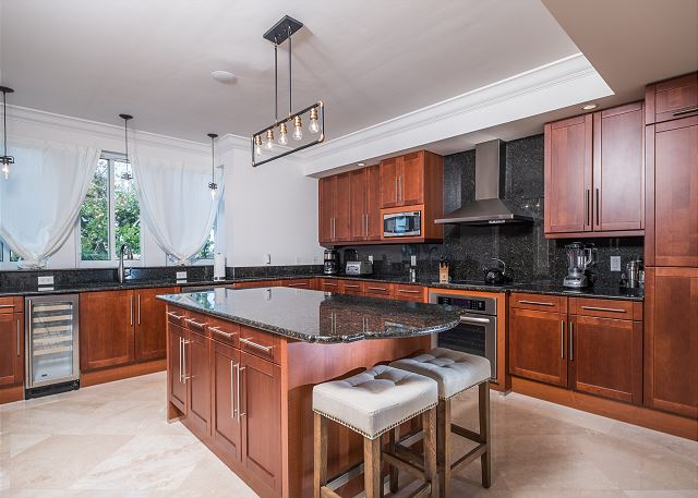 Residence #3822 - Fully Furnished Spacious Kitchen with Center Island and Adjoining Laundry Room