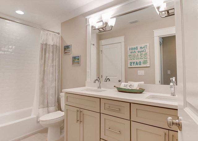 2nd Floor Guest Bathroom with a Double Vanity and Shower/Tub Com