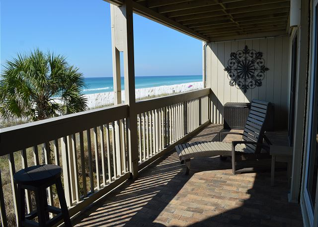 This southern facing gulf front tiled balcony has a lounger, 2 bar stools, a bistro table and 2 chairs for your Beach Vacation