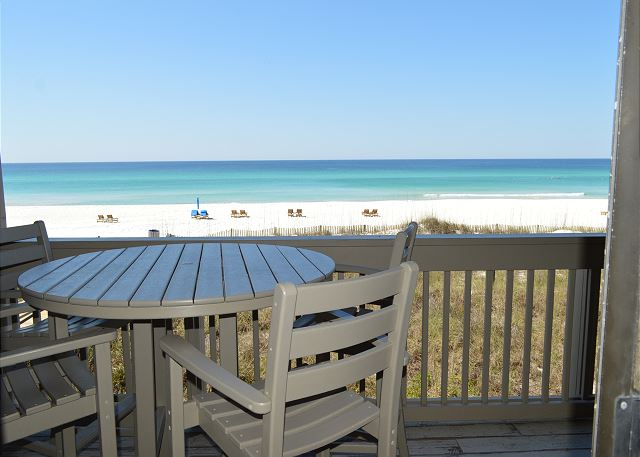 Gulf Front Vacations at its Best!  Views, outside dining table and chairs, beach loungers with cushions & umbrella in the sand from March to October.