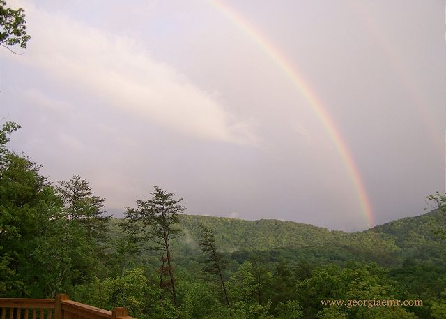 Magic moments under the rainbow after a thunderstorm