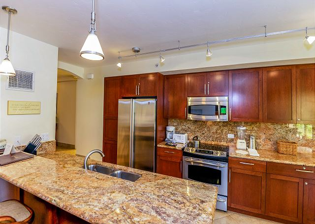 Plenty of granite counter space to prepare your food with, congregate and enjoy!