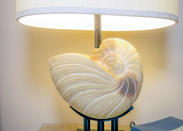 Nautilus Shell Lamp right next to the bed.