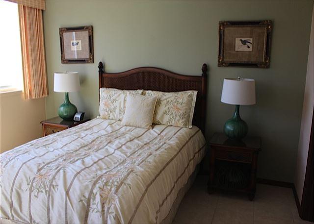 Bedroom with view of ocean.  Queen sized bed.