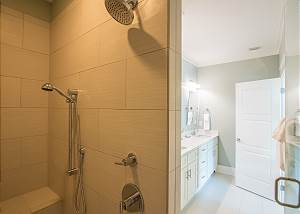 Master bath includes a walk in shower with spa and rain shower heads.