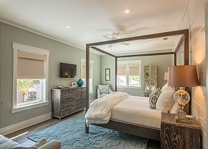 King Master Suite with canopy bed, flat screen TV, sitting area, and en suite bath