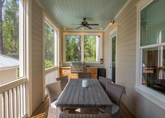 Outdoor dining on the screened in, covered side porch. Fantastic private outdoor spaces!