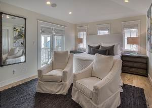 King Master Suite with private balcony and cozy seating area