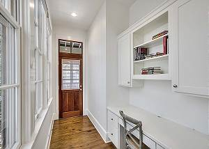 1st Floor hallway office with chair and built in desk. Wifi available in home. Door leads to screened in back porch