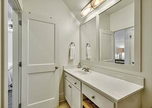 En suite bath with vanity sink and sitting area