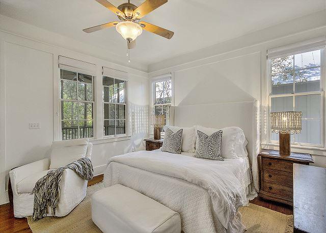 Designer bedding and upholstered headboard.
