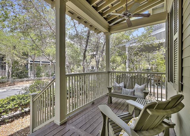 Front porch with views of Watercolor. Ceiling fans available to keep you cool!