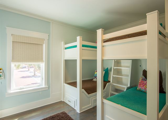 Bunk suite with sleeping for 4 in custom twin bunks. Includes flat screen TV and en suite bath