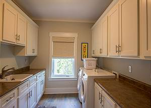 Laundry room with full size HE washer and dryer plus sink and lots of counter space