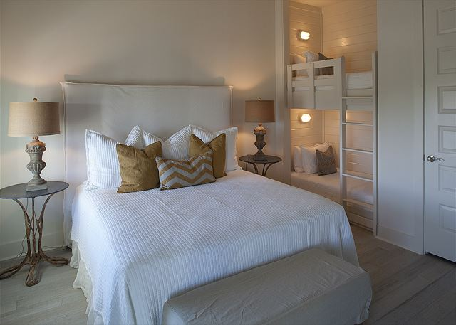 2nd floor King Suite with twin built in bunk. Private balcony access.