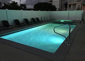Swim into the night thanks to colorful pool lights!