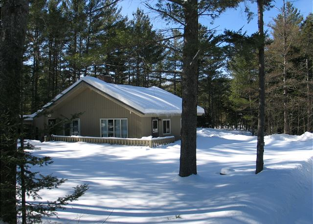 A view of the property draped in the white stuff northern New Hampshire is known for.
