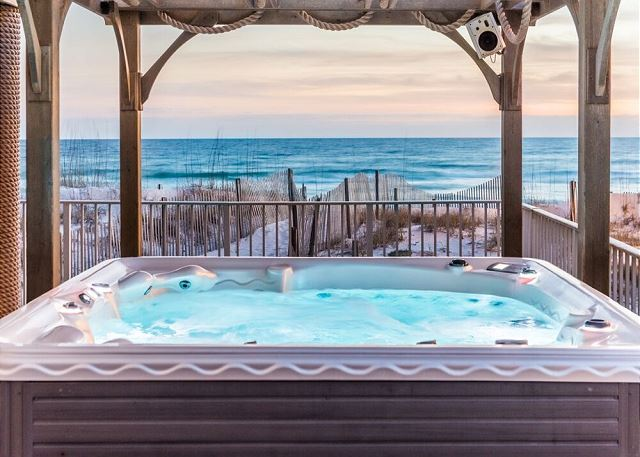 Imagine watching the surf gently wash ashore from this private hot tub.