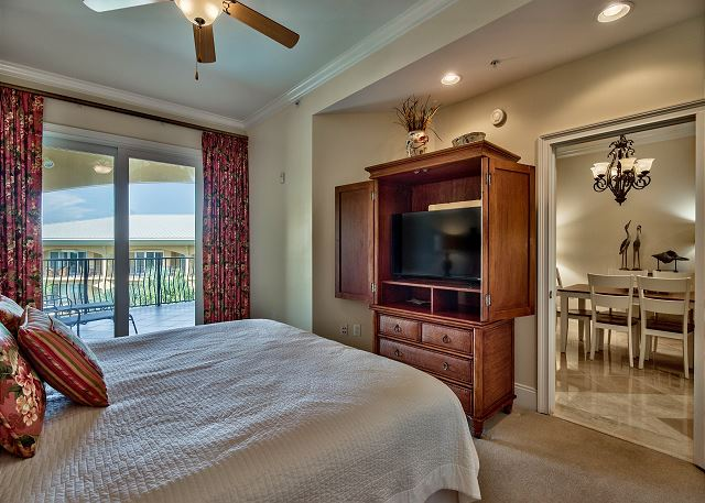 Master bedroom with large flat screen TV