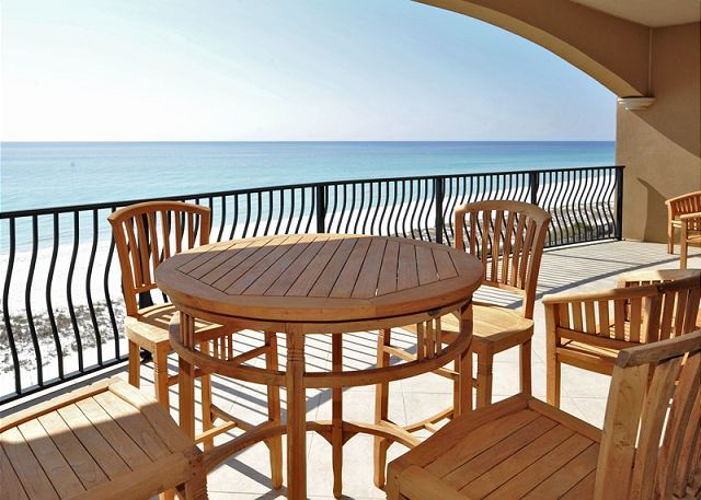 Teak furniture on balcony overlooking gulf