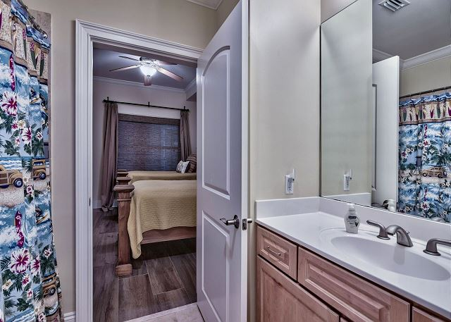 Third bathroom that connects twin bedrooms.