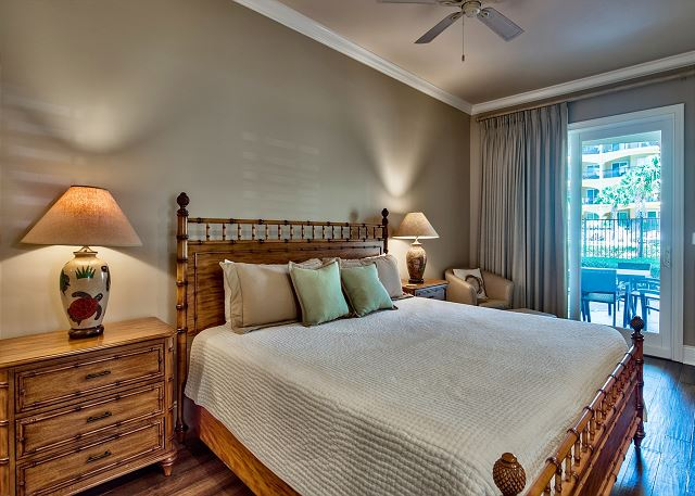 Adagio G105 master bedroom with sliding glass doors to the patio