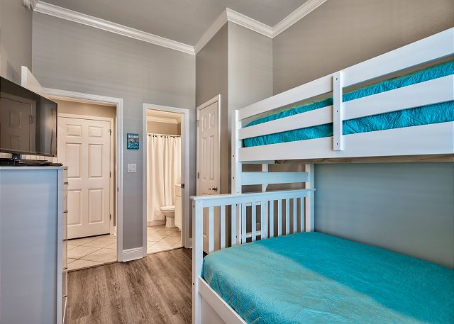 Bunk room with adjoining bathroom